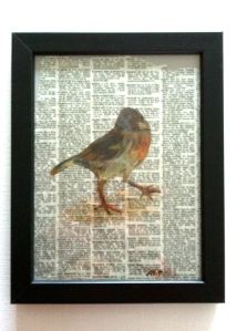 Bird painting on newspaper