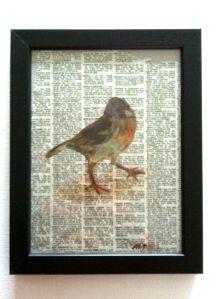 Bird painting on newspaper